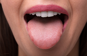 woman performing tongue exercise